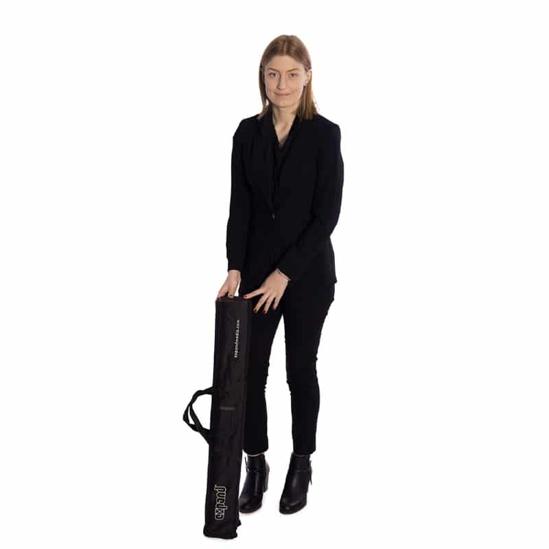 model standing with media screen 1 black carry bag