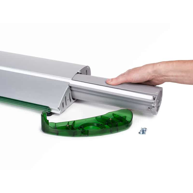 hand removing graphic cartridge from qs3 banner stand display base hardware