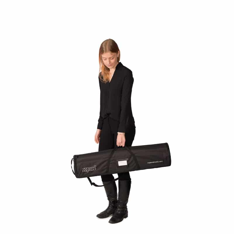 woman holding black carry case for quickscreen 3 banner stand display