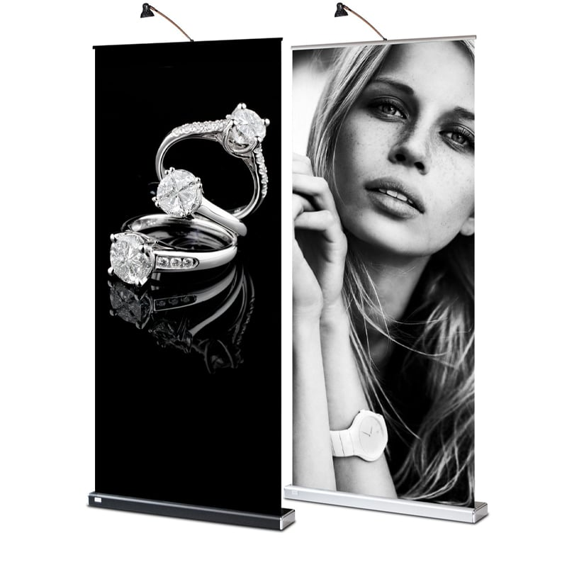silver and black m2 banner stand displays standing together