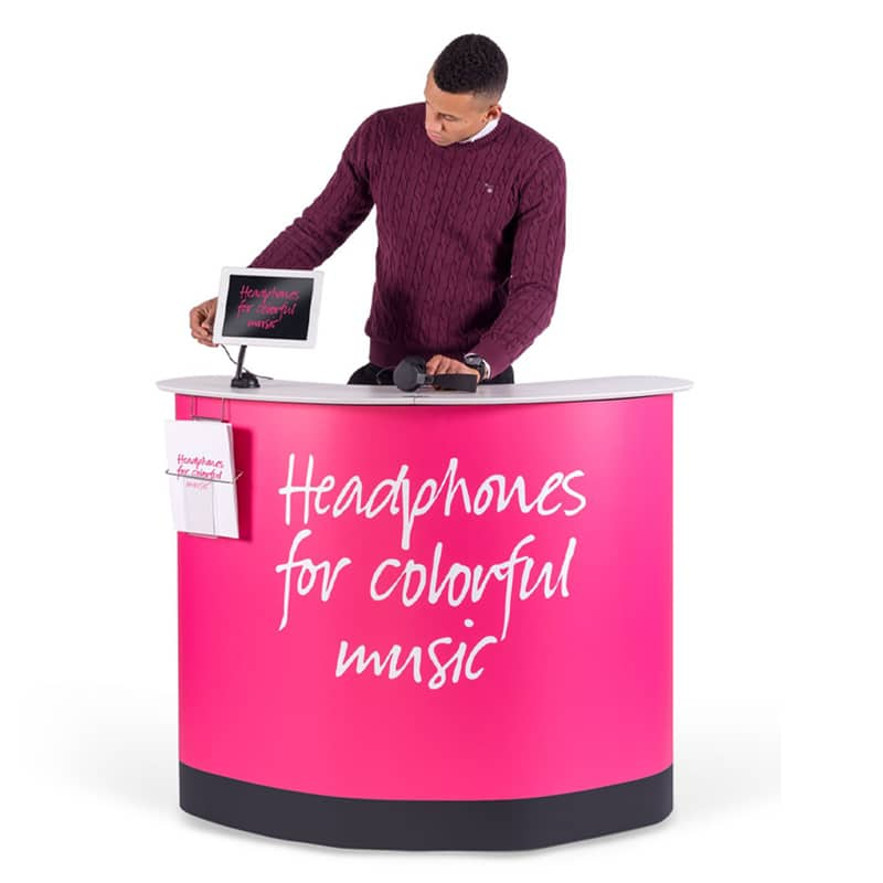expand podium case counter with model standing behind showing iPad mount and literature accessories