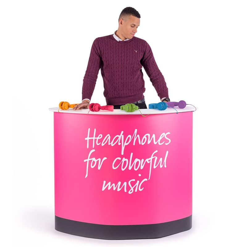 expand podium case counter with model standing behind and products on counter