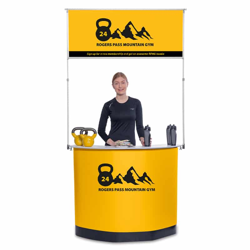 model standing behind expand podium case counter, optional banner hardware overhead