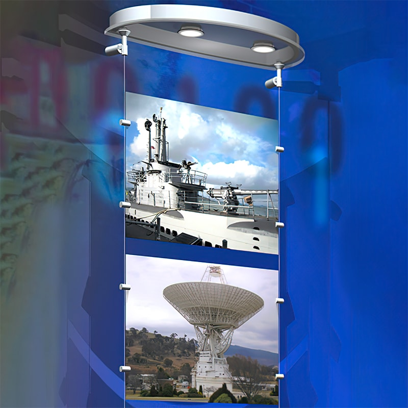 suspended cable graphics hanger showing photos on a display