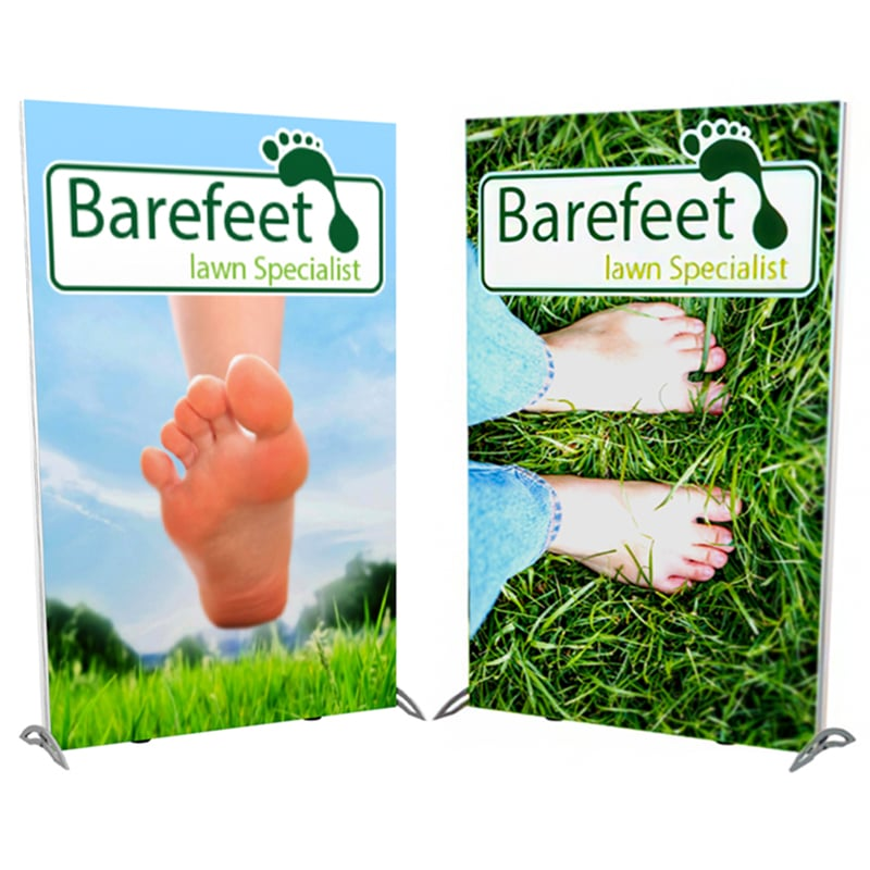 showing both front and back of 5 foot double-sided lightwall display, photos of grass and bare feet for lawn care company