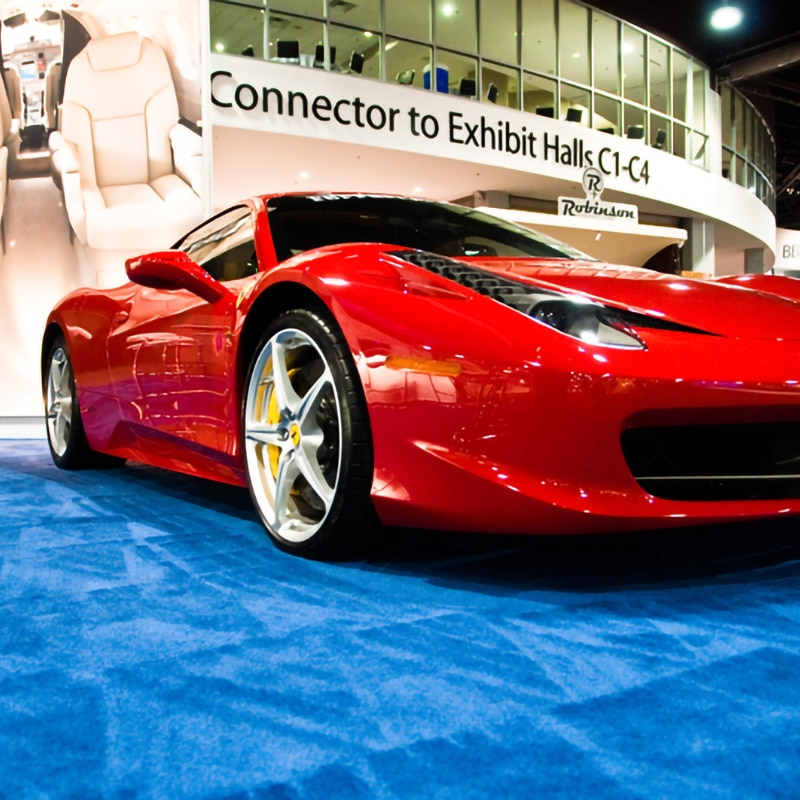 advantage xl show carpet gallery example, blue carpet with red sports car in showspace