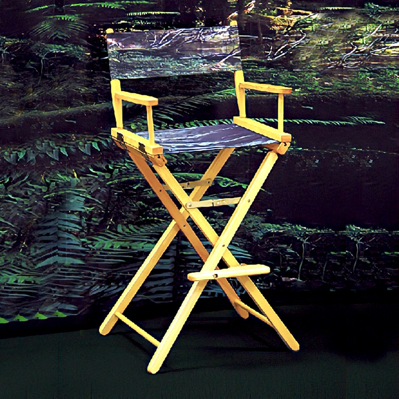 tall director's chair natural frame with fully printed camouflage fabric to match display behind