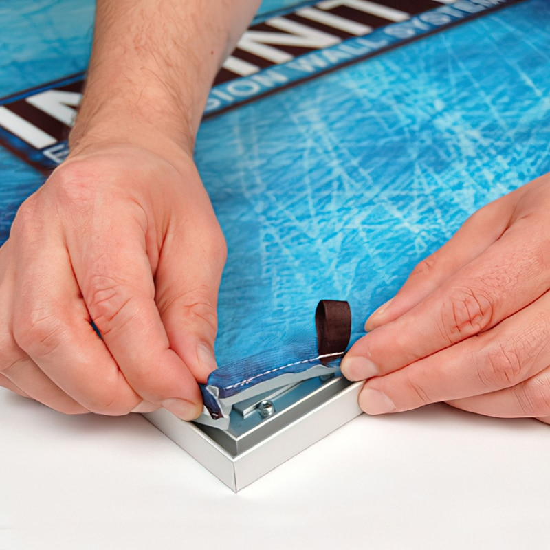 Create a taut graphic by inserting the SEG (silicone graphic edge) into the groove on the perimeter of the frame, step 1