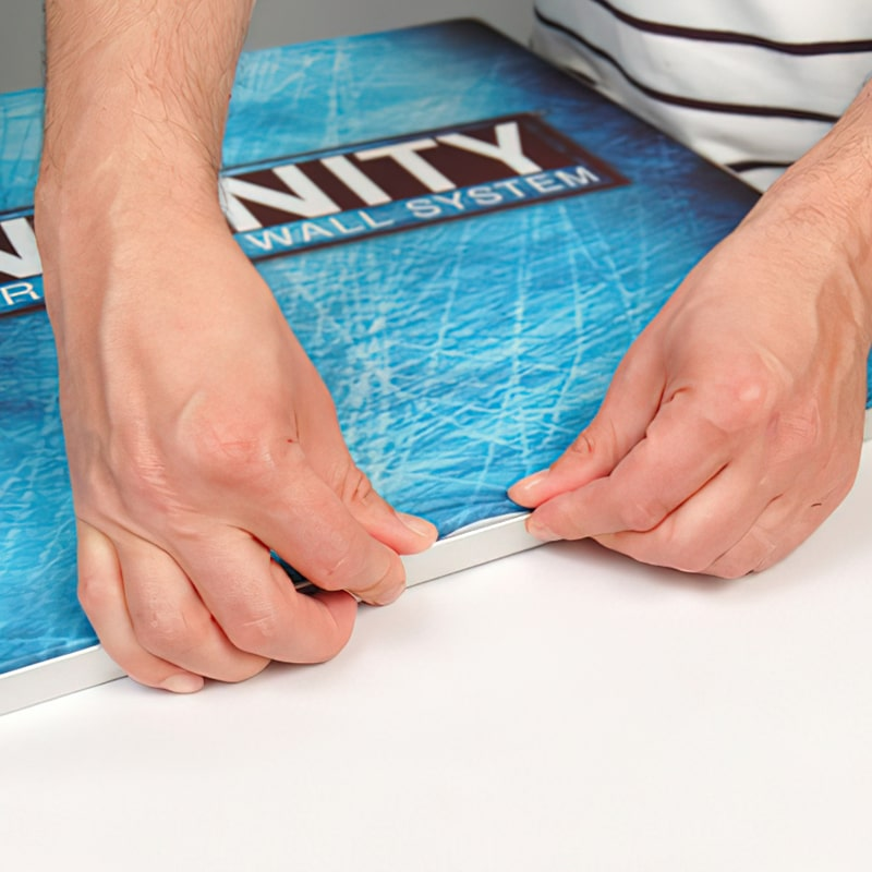 Create a taut graphic by inserting the SEG (silicone graphic edge) into the groove on the perimeter of the frame, step 2