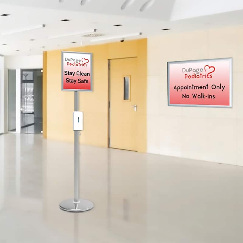 post sanitizer stand with sign, photo in building hallway