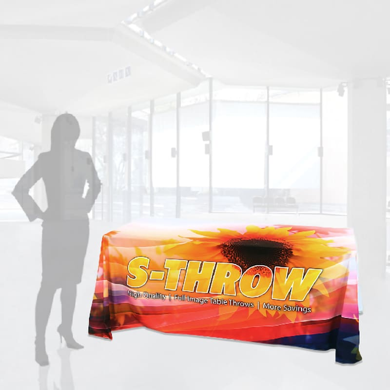 """6 foot dye sublimation fully printed table cover with bright flower and text, """"s-throw"""" with woman silhouette for scale"""